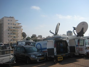 A few of the media satellite trucks in the parking lot