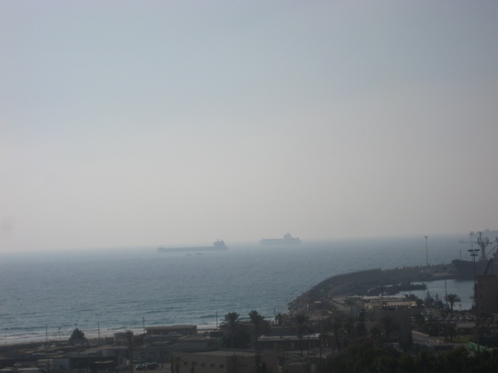 The end of the fauxtilla: the French 'yacht' Dignite al Karama is escorted into port by an Israeli naval vessel. But which boat is the naval vessel and which boat is the yacht?  Find out below.