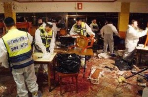 Israeli 'Zaka' personnel picking up Israeli body parts inside Haifa's Maxim Restaurant on October 4, 2003