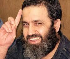Why is Hezbollah terrorist Mustafa Dirani smiling today?