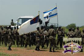 Soldiers of the South Sudanese Army waving an Israeli and a Christian flag (photo courtesy of the Christian website: www.supportisrael.us)