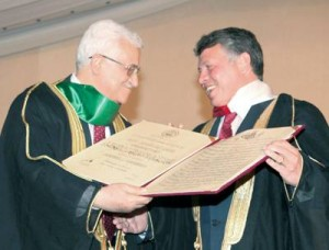 A jovial King Abdullah (no doubt laughing at the sheer hypocrisy of the situation) receiving his bogus Al-Quds University ' honorary doctorate' from Palestinian President Mahmoud Abbas