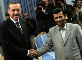Turkish PM Erdogan shaking hands with one of his friends