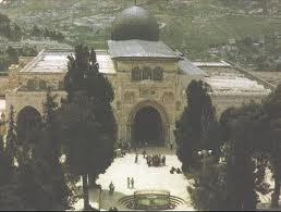 "The Al-Aqsa Mosque, ""The Farthest Mosque"", located across the courtyard from the Dome of the Rock--both built over the site of First and Second Jewish Temples in an attempt to defile Judaism"