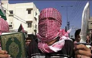 Draw your own conclusions dear reader: a young Palestinian terrorist with his Koran in one hand and a knife in the other. (This is not a picture from yesterday's event).