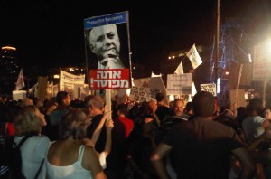 "A picture from last night's demonstrations. Note the poster of Netanyahu. The blue part above his picture reads ""The National Left"". The red part below his picture reads ""YOU'RE FIRED!"" Read the blog below for latest poll numbers if an election were held in Israel tomorrow."