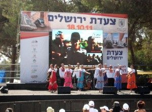In Jerusalem's Sacher Park yesterday at the moment when images of Shalit first came on Israel TV. Note that a dance troupe was performing on stage at the time.