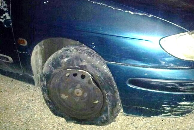The terrorist strategy: puncture the tires, force the car to stop, kidnap or kill the driver.  Fortunately, the driver of this car last night kept driving on punctured tires.