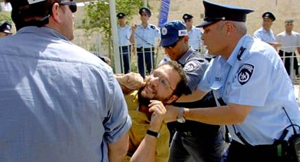 The Jerusalem Police arresting a Jew beside the Temple Mount a month ago at Passover.