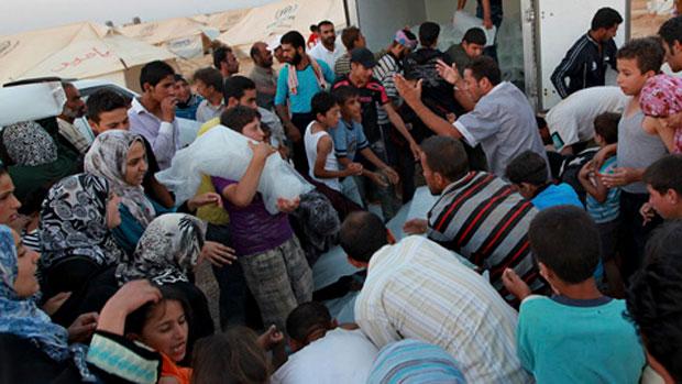 Syrian refugees in Jordan clamoring for food.