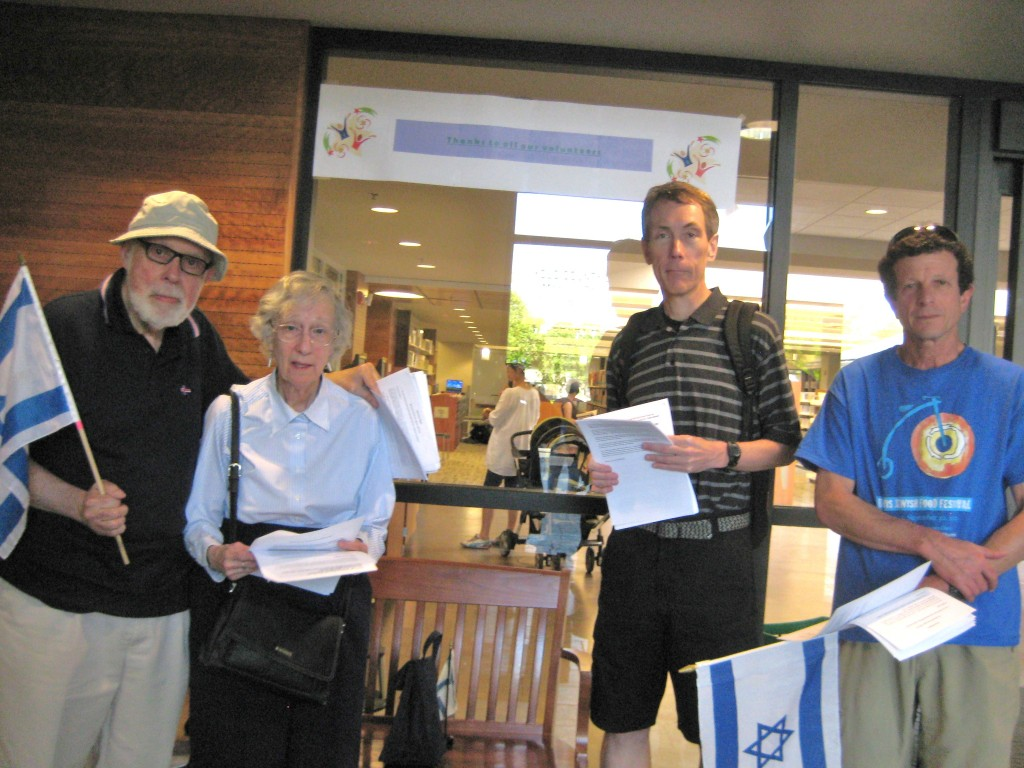 "Some of our people at the front door of the library ""to greet"" those coming to the program."