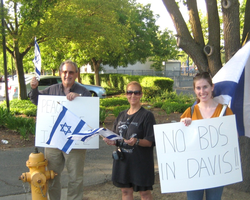 On the other side of the entry to the parking lot. We were particularly pleased to have the head of the local student chapter of Christians United for Israel--CUFI (woman in the right of the photograph) with us yesterday.