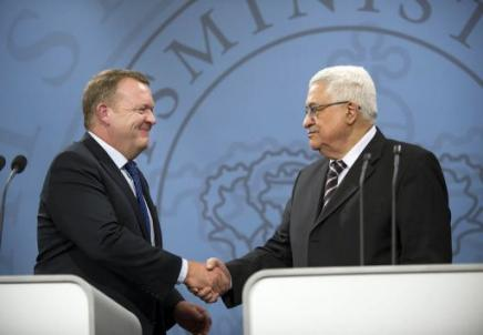 Danish Prime Minister, Lars Lakke Rasmussen (left) shakes hands with his longtime friend, PLO head Mahmoud Abbas. Denmark has long done everything it can to undermine Israel.