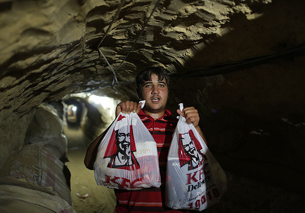The KFC delivery man arrives through the tunnel into Gaza.
