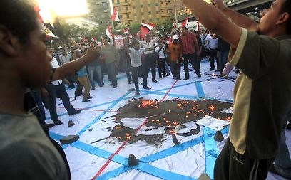 Burning the Israeli flag in Cairo's Tahrir Square this morning. What better way to incite the crowd that to claim that the Morsi and the Muslim Brotherhood are Zionists?
