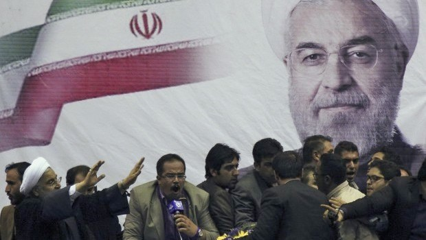 Hassan Rohani (in lower left of picture) in front on a giant banner of himself in the Iranian city of Shiraz a few days ago.