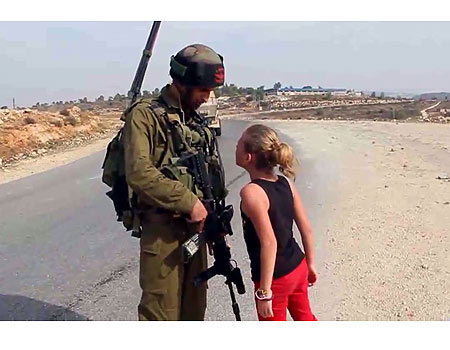 "This picture, posed by Nariman, of her daughter supposedly berating an Israeli soldier, became an international ""human rights"" sensation."