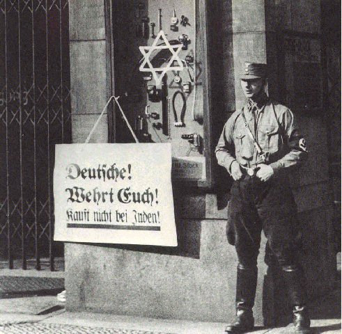 """Germans protect yourselves. Do not buy from Jews"" reads the sign--Europe is back to 1933 again."