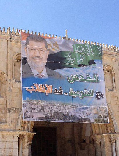 This pro-Morsi banner was hung by Hamas on the Al-Aksa Mosque yesterday.