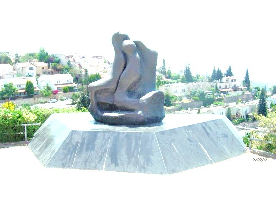 The tragic monument at the entrance to Alfei Menashe remembering Ofra Moses and her son Tal. If you look closely, you can make out the charred figure of Ofra still in her car seat--with Tal closely behind her.
