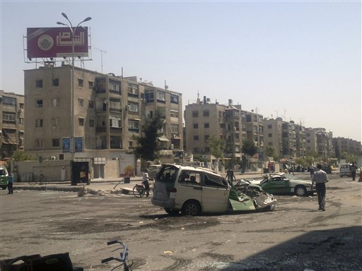 The Palestinian suburb of Damascus--a place of broad avenues, high rise apartment buildings, and internecine Palestinian warfare.