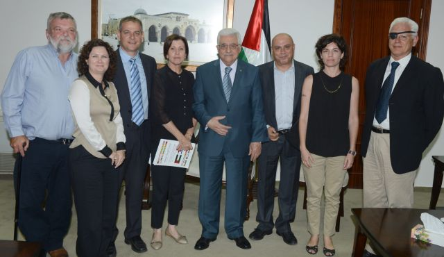 Mahmoud Abbas and his willing dupes on the Left--all members of Israel's Meretz party--in his Ramallah office two days ago (photo: Haaretz)..
