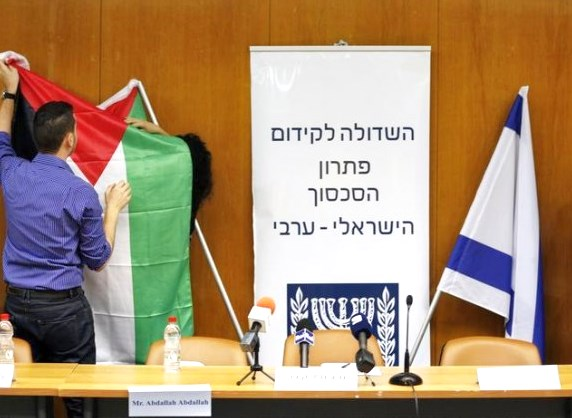 "Five days ago in the Knesset: a Palestinian flag is unfurled ""in honor of"" a visiting delegation from the PLO."
