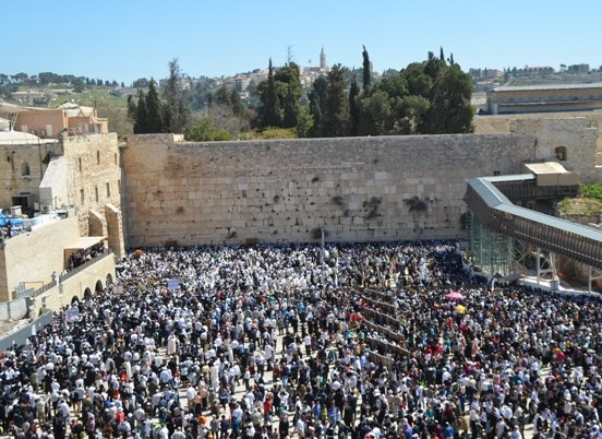 Jews praying at the Kotel--Western Wall--a site with no Jewish history whatsoever (if you believe the PLO). Photo source: israellycool).