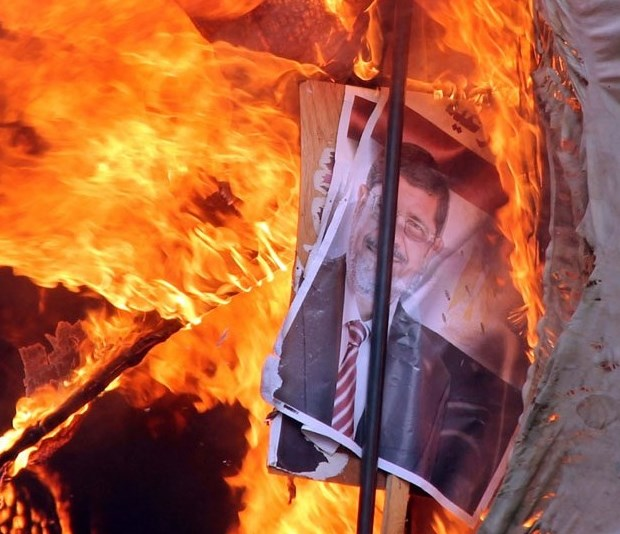 One of the many pictures streaming out of Egypt today: a pro-Morsi protest tent goes up in flames.