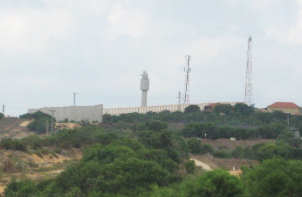 This is in the Chof Ashkelon region. Gaza is on the other side of the wall on top of the hill. Note the Israeli guardtower and the beginning of the Jewish community on the top right of the hill.