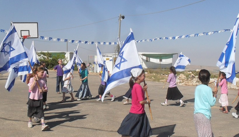 The kids of Ramat Migron march with Israeli flags.