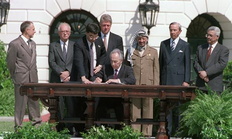 What a lovely picture. Shimon Peres signing the Oslo Accords on the White House lawn with Yitzhak Rabin to the left and Mahmoud Abbas to the right (with fellow terrorist Yasser Arafat just behind Peres' left shoulder.