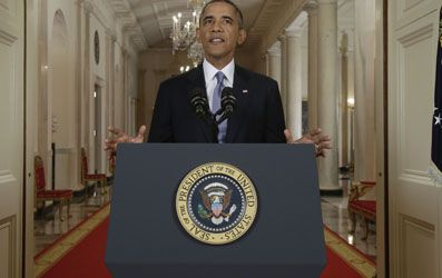 Obama speaking last night--as disingenuous as always (picture source: Associated Press).