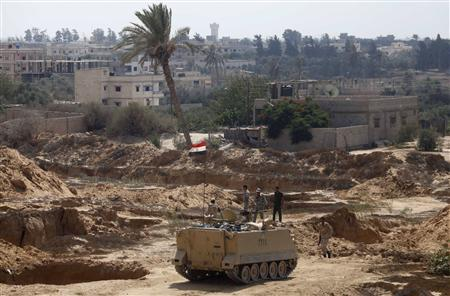 Note the Egyptian tank in the foreground and cleared land in the background near Rafah (picture source: Reuters).