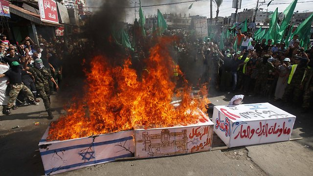 An Israeli coffin being burned in Gaza yesterday by our new found Hamas friends: one of many such burnings throughout Gaza.