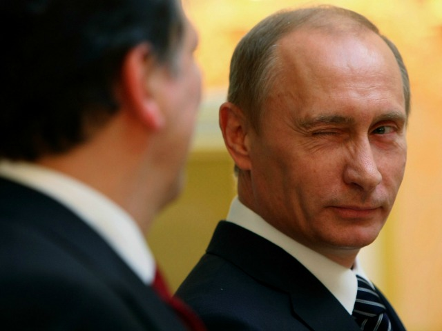 The famous Putin wink, recorded by a photographer from the Associated Press.
