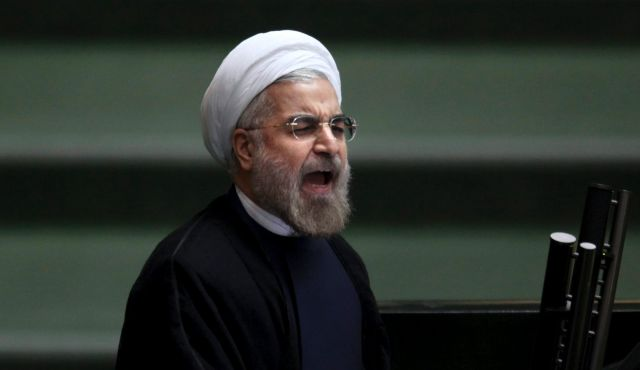 Iranian president Hassan Rohani addressing the Iranian parliament--not the smiling picture of Rohani that the western media likes to portray (photo source: AP).