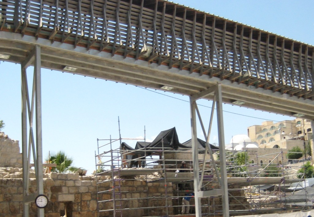 "A picture your humble servant took from the men's section in front of the Kotel (Western Wall) several months ago. Note the Mughrabi ""ramp"" overhead and the workers attempting to restore the original ramp underneath."