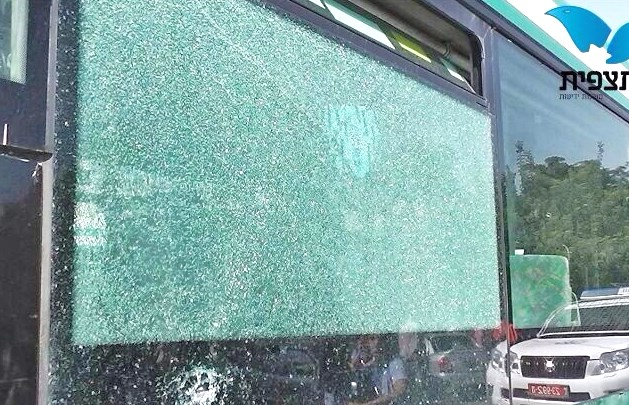 This a picture of one side of the bus. Note the police car in the reflection (picture source: Observation Agency).