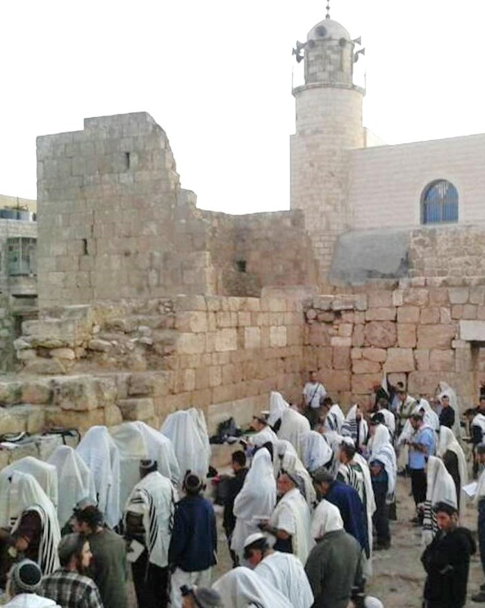 Praying this morning on Mt. Hebron at the site of the ancient synagogue. Notice how the Muslims built a synagogue over the beside the Jewish place of worship which was subsequently destroyed (picture source: Observation Agency).