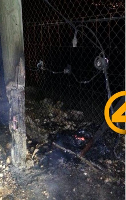 This picture from two nights ago shows how Palestinian terrorists set fire to a tire to try to burn through a Samarian community's security fence (picture source: 404).