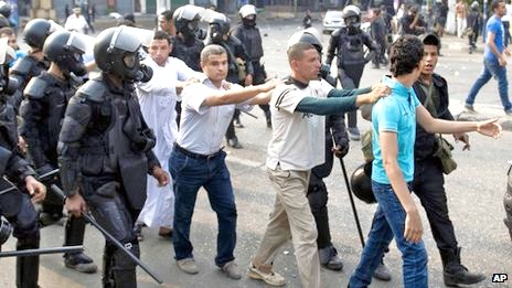 Hi ho hi ho, it's off to prison we go. Members of the Muslim Brotherhood are taken away by the Egyptian police yesterday (photo: BBC).