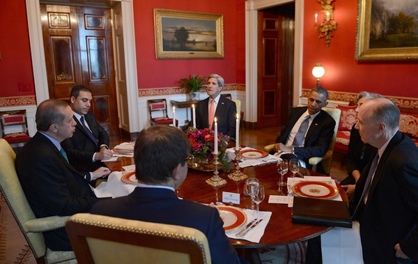 Exactly who knew what when? This picture was made in Washington in mid-May of this year. Sitting around the table (left to right):