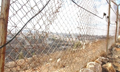 The place where the terrorist cut the hole in the Psagot fence. Note Ramallah on the other side (photo: JPost).