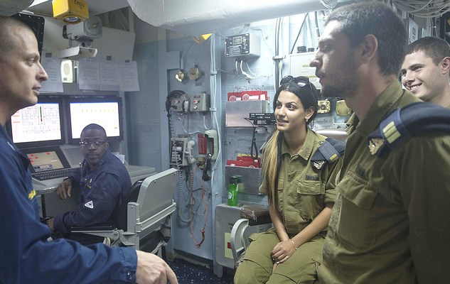 Israeli naval officers (in green) being given the tour.