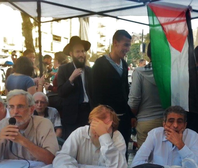The meeting in Jerusalem yesterday of anti-Zionist rabbis, Palestinians, and Israeli leftists.