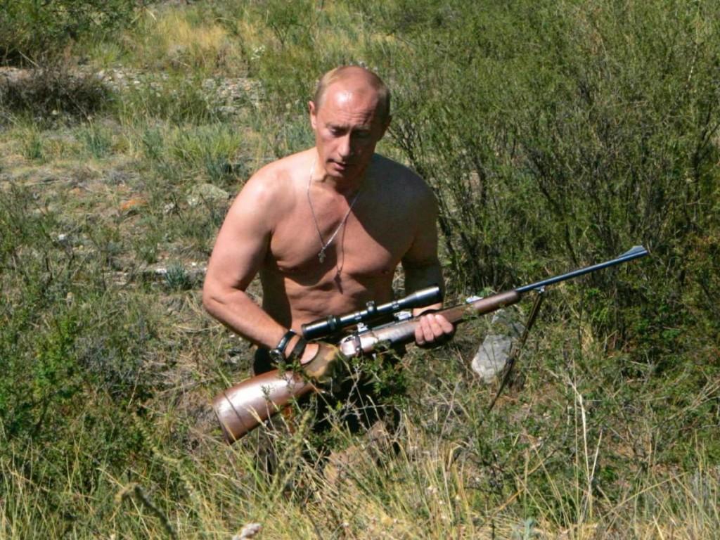 "Vladimir Putin in one of his favorite ""peaceful"" poses."