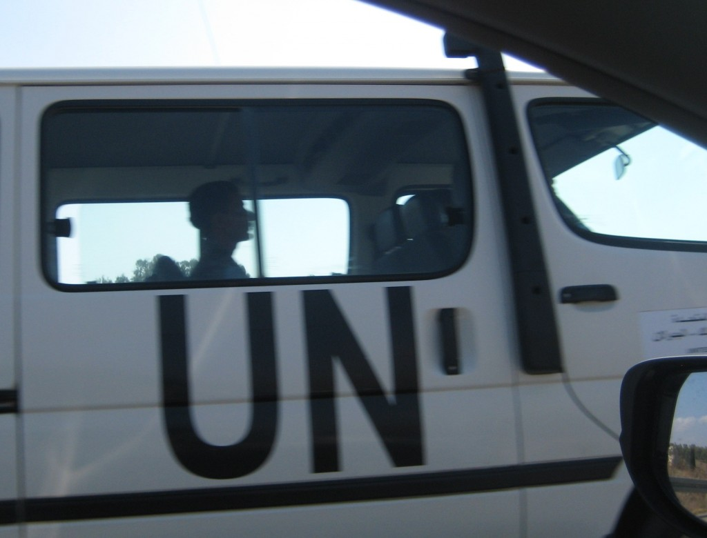 A crazy UN driver passing us on the curvy road.