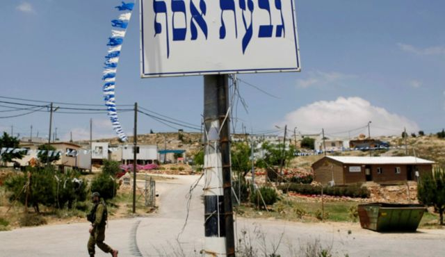 Givat Assaf--so reads the sign in front of this fledgling Jewish community (picture: Haaretz).