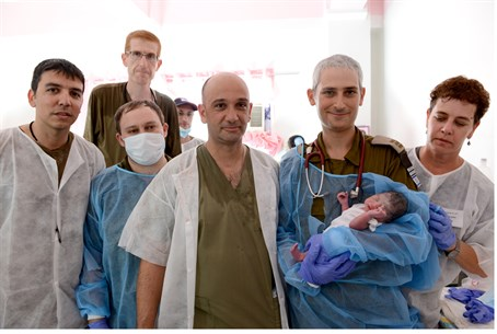 "The Israeli medical team with young ""Israel"" (photo: IDF Spokesman's Office)."
